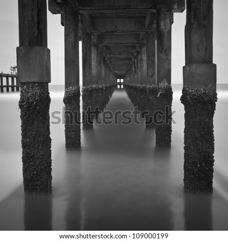 long exposure under the pylons, black and white image