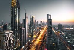Long exposure view of traffic and skyline from rooftop at sunset Dubai - UAE