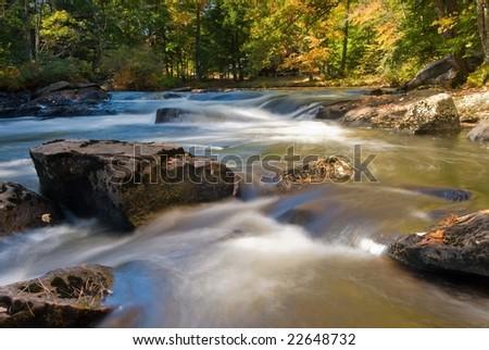 Long exposure wide angle shot of an idyllic fresh river