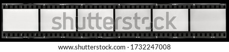 Photo of  long film strip, blank photo frames, free space for your pictures, real high-res 35mm film strip scan.