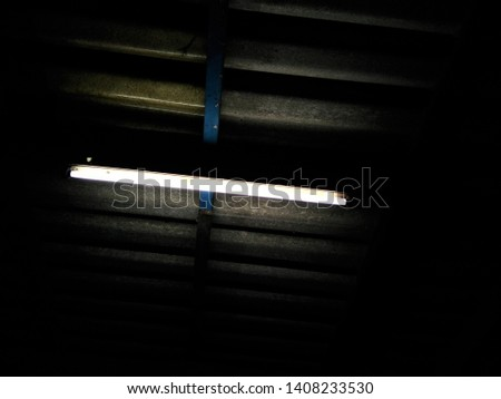 Long fluorescent lamp is under the roof.