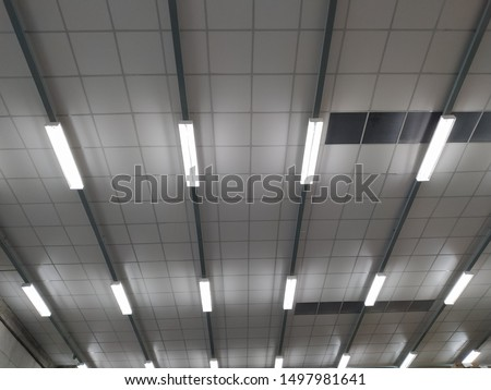 Long fluorescent light lamp under the ceiling In the building.