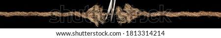 Long frayed rope ready to break apart with rope held together by last strand with scissors ready to cut it apart. Concept of dangerous stress or stressful situation like ominous threats or failure. Foto stock ©