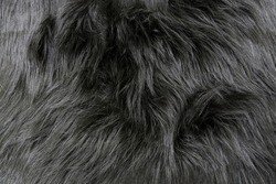 Long gray coat of a bear or dog close up. Faux fur fabric. Artificial fur fabric texture, useful as background