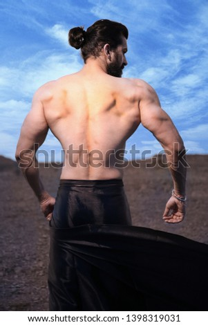 long hair Asian muscled fit male model man posing outdoor against blue sky showing his back muscles - Image