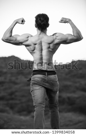 long hair Asian muscled fit male model man posing outdoor showing his back muscles black and white - Image