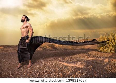 Long hair Asian Young handsome muscled fit male model man posing outdoor showing his abdominal muscles cloth flying in air fantasy style - Image