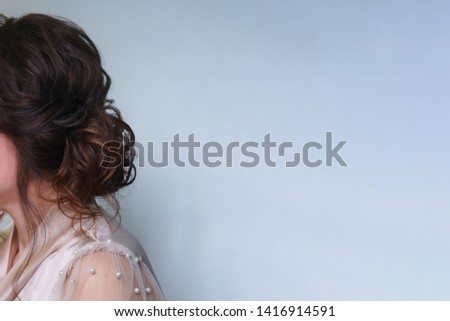 Long hair in hairstyle, ombre, styling in beauty salon. Side view. Wedding and prom ball hairstyles. Beauty industry