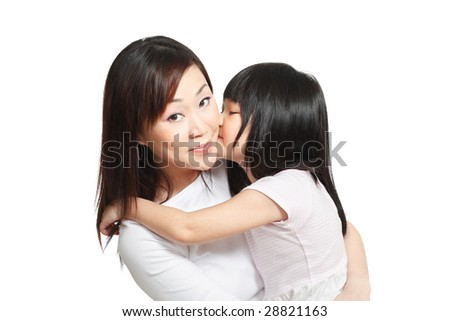 Long hair little chinese girl giving her mother a kiss on the cheeks. - stock photo