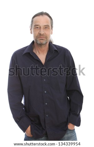 Long hair man wearing black long sleeve with hands on his pocket