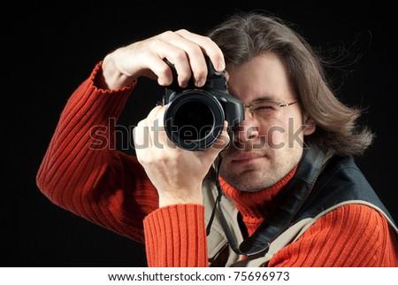 Long hair man with camera
