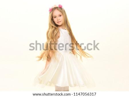 long hair. small girl with long hair. long hair of pretty kid. long hair treatment. time for new haircut