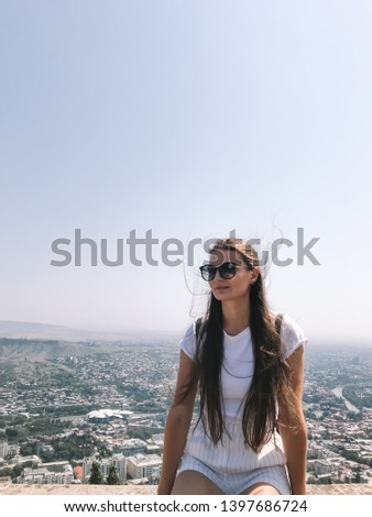Long hair woman at camera. city view panorama from high hill on background. Tbilisi panorama view.  #1397686724