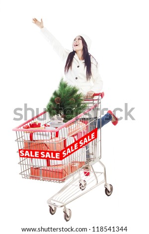 Long hair woman with trolley is shopping during Christmas sale