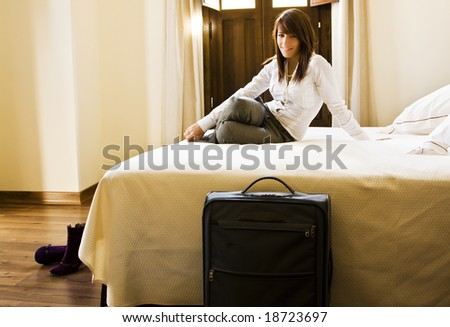 Long haired businesswoman resting in bed.