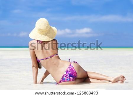 long haired girl in bikini on tropical bali beach