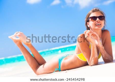 long haired girl in bikini on tropical barbados beach #245454298