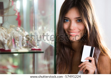 Long-haired girl with card