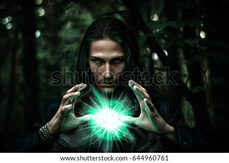 Long haired white male with a mystical glowing orb to signify power, magic, spirituality and so forth #644960761