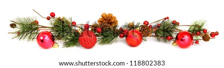 Long horizontal Christmas border with baubles, tree branches and berries over white