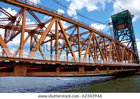 Long iron bridge over a river - stock photo