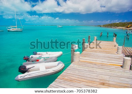 Long Island, Bahamas - inflatable dinghies are tied to a dock in Salt Pond on Long Island, Bahamas