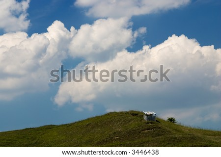 Long journey to the top, Little shepherd house against cloudy sky
