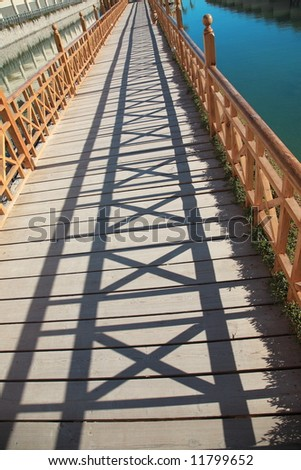 long lagoon bridge with the play of light and shadow