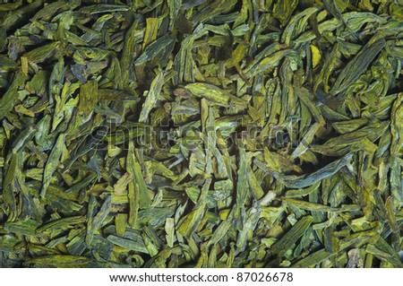 "Long leaves green loose  tea ""Dragon well"",  background, texture"