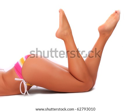Long legs of relaxed woman with bikini.