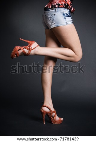 Long legs sexy women in red shoes
