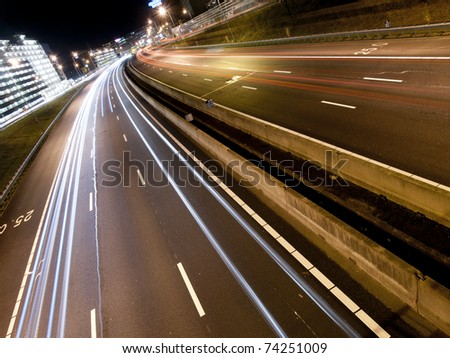 Long light trails from cars on a modern freeway