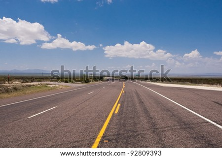 Long lonely road in vast open spaces of west Texas