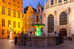 Long Market Street with Fountain of Neptune at night in Old Town of Gdansk, Poland