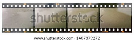 long 35mm filmstrip with 4 empty or blank frames or cells on white background with interesting light surface, just blend in your work to get that old film effect, real scan