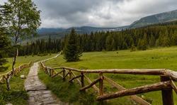 Long mountain trail with panorama of Karkonosze Giant Mountains around