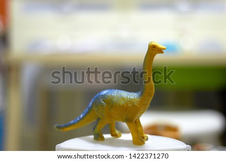 long neck tall Dinosaur toy figure on blur background #1422371270