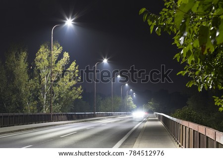 long night street with modern LED street lights #784512976