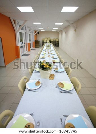 Long party table ready for guests to sit down