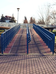 long passage over the wheelchair-accessible road