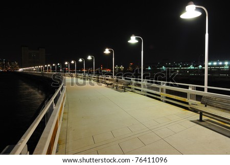 Long pier with lights in the distance on Manhattan's West Side.