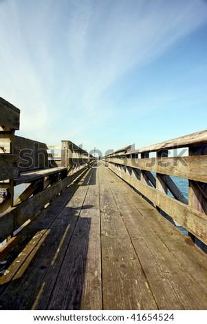 Long pier with vanishing point at horizon