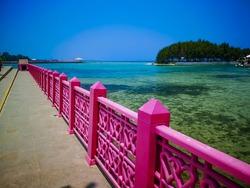 Long pink bridge on a beautiful island