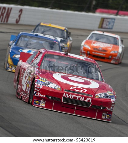 LONG POND, PA - JUNE 06:  Juan Pablo Montoya races off turn three for the Gillette Fusion ProGlide 500 race at the Pocono Raceway in Long Pond, PA on June 6, 2010