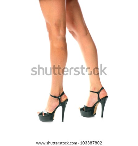 Long pretty woman legs, isolated on white background, sexy female legs in shoes