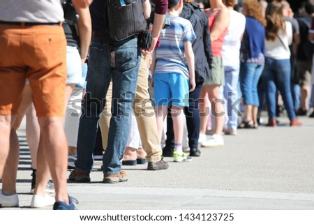 Long queue of people waiting in line Photo stock ©