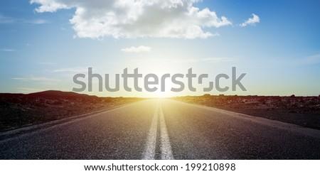 Long road at sunset