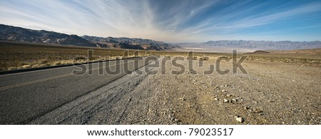 Long road in Death Valley National Park, California. Death Valley is a desert valley located in Eastern California.