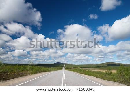Long road to green hills.  Kola Peninsula.
