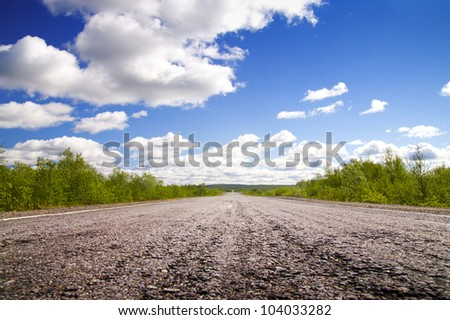 Long road to green hills.  Kola Peninsula. Murmansk - stock photo